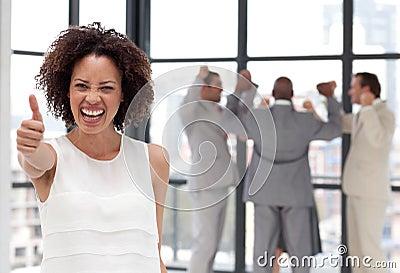 Smiling business woman showing team spirit