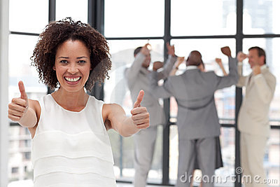 Smiling business woman showing team spirit