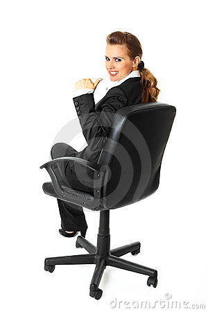 Smiling business woman showing thumbs up gesture