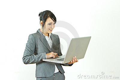 Smiling business woman standing holding laptop