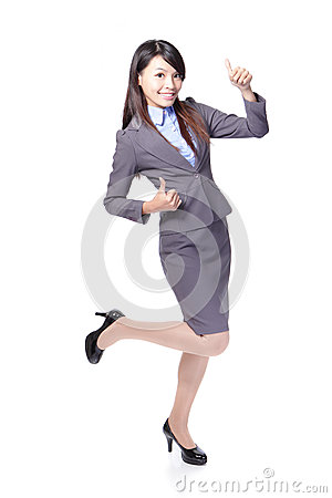 Smiling business woman with thumbs up