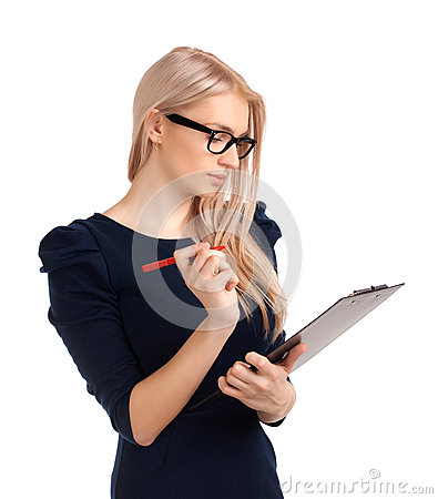 Smiling business woman writing on clipboard