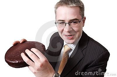 Smiling  businessman with chocolate pie in hands