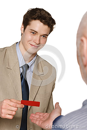 Free Smiling Businessman Giving His Identity Card Royalty Free Stock Photo - 31593075