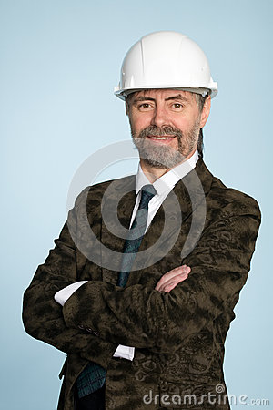 Smiling businessman in helmet