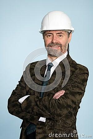 Smiling businessman in helmet