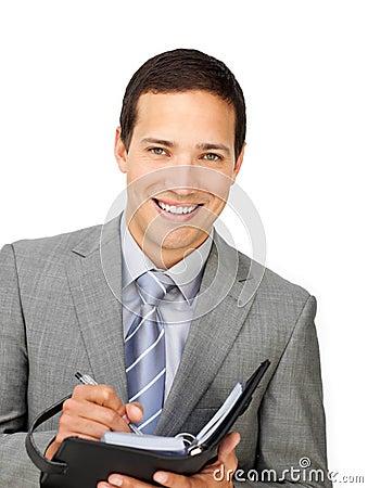 Smiling businessman holding an agenda