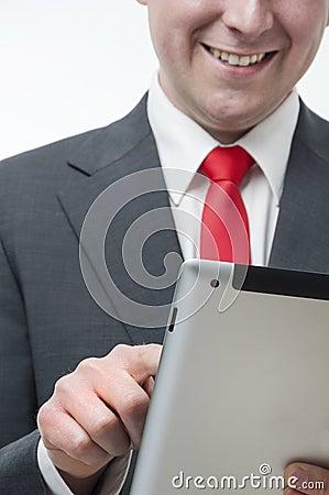 Smiling businessman holding digital tablet