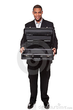 Smiling businessman holding empty open briefcase