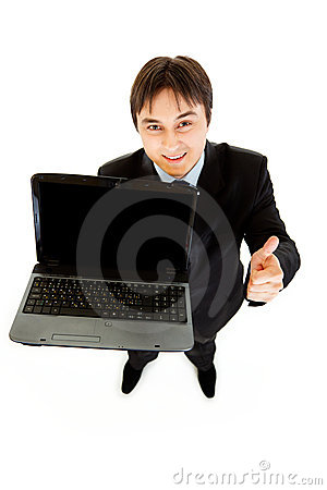 Smiling businessman holding laptops blank screen
