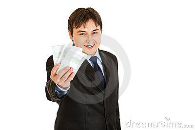 Smiling  businessman holding money in his hand
