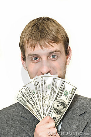 Smiling Businessman with hundreds of dollars
