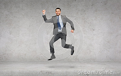 Smiling businessman jumping