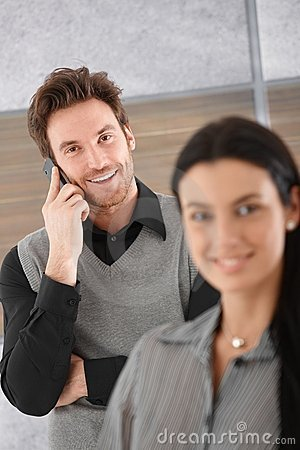 Smiling businessman on mobile Stock Photo