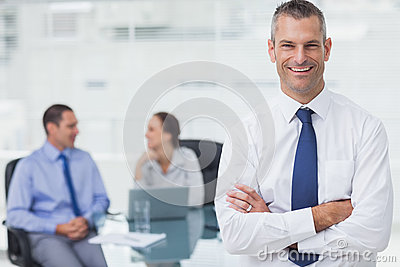 Smiling businessman posing crossing arms