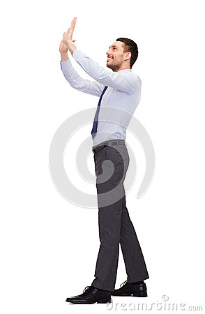 Free Smiling Businessman Pushing Up Something Imaginary Stock Photography - 40041262