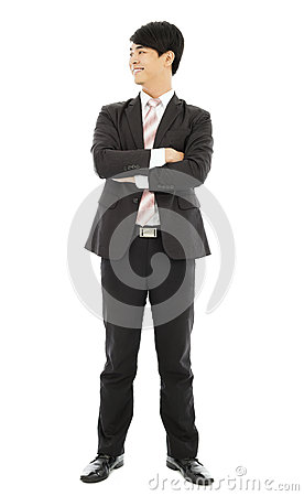 Smiling businessman standing and crossed arms
