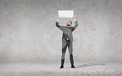 Smiling businessman with white blank board