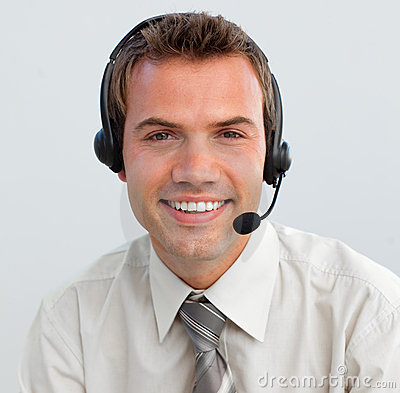 Free Smiling Businessman With A Headset On Stock Photo - 11853330