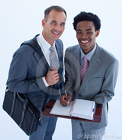Smiling businessmen writing in a business diary