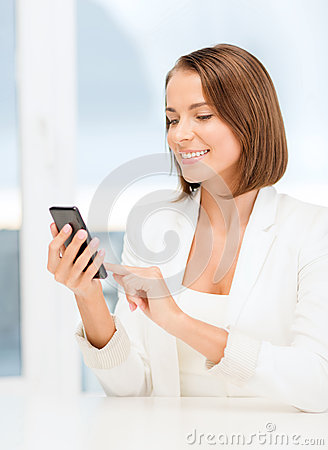 Smiling businesswoman browsing in smartphone