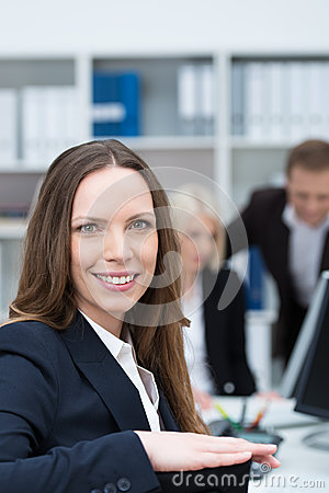 Smiling businesswoman in a busy office
