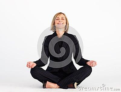 Smiling businesswoman doing yoga exercises