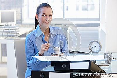 Smiling businesswoman having coffee break