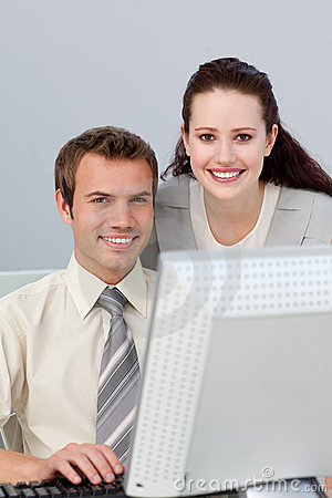 Smiling businesswoman helping her colleague