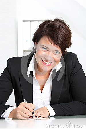 Smiling businesswoman at her desk