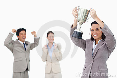 Smiling businesswoman holding cup