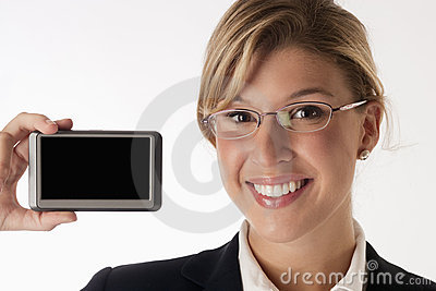Smiling businesswoman holding device with blank sc