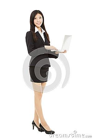 Smiling businesswoman holding laptop