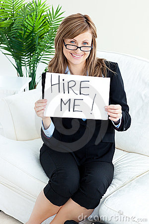 Smiling businesswoman holding a paper