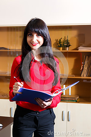 Free Smiling Businesswoman In A Red Blouse With A Folder Stock Photography - 59121722