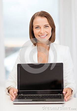 Smiling businesswoman with laptop computer