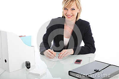 Smiling businesswoman seated at a desk