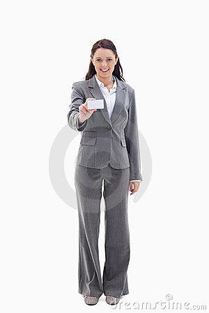 Smiling businesswoman showing a card