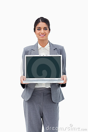 Smiling businesswoman showing her laptop