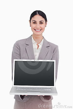 Smiling businesswoman showing screen of her laptop