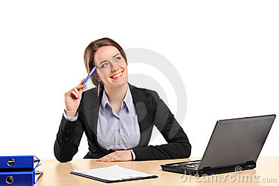 Smiling businesswoman in thought posing