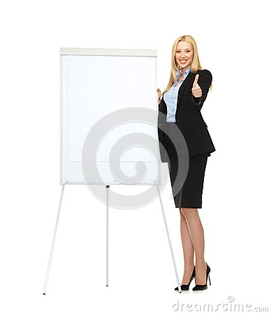 Smiling businesswoman with white blank flipchart