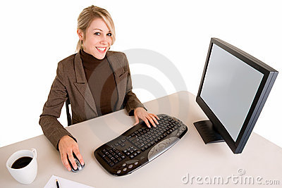 Smiling Businesswoman Working on her Computer
