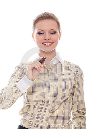 Smiling businesswoman writes a marker in front of