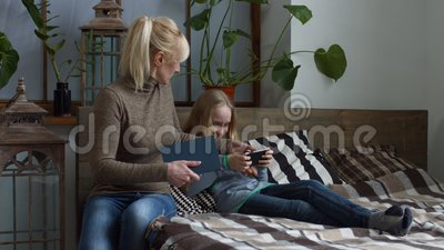 Strict mother making her daughter to do homework stock video