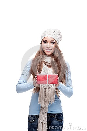 Smiling casual winter girl holding christmas gift