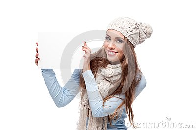 Smiling casual winter girl holding sign