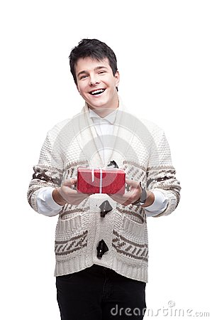 Smiling casual winter man holding christmas gift