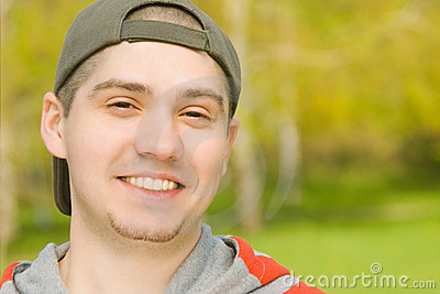 Smiling Casual young male in park