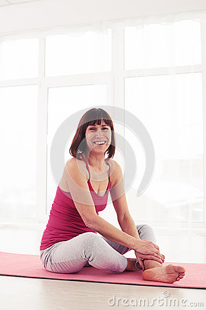 Smiling charming woman resting after yoga workout